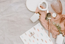 Flat Lay Wedding Or Festive Table Setting. Plates And Cutlery With Gray Decorative Textile On White Background. Beautiful Arrangement.