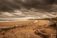 A Walk Along The Coastline Of Tynemouth Longsands At Cullercoats Bay Near Newcastle, UK
