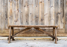 Wood Bench Against  Wood Plank...