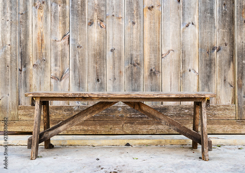 Wood bench against  wood plank wall Canvas Print