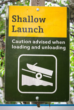 A Shallow Boat Launch Sign Advising Caution