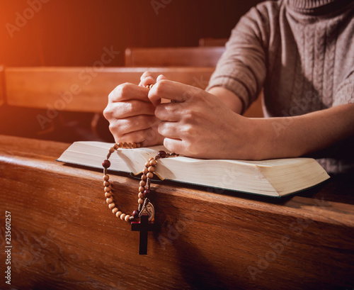Christian woman praying in church  Hands crossed and Holy