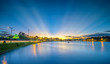 The sunset on the shores of a large lake with the rays of sunlight radiating up to the skies impressive to finish a day in the mountain city of Vietnam.