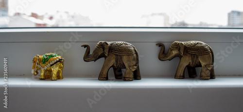 a three souvenir elephant on a white background Wallpaper Mural