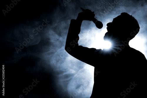 Singer singing silhouette - 235612404