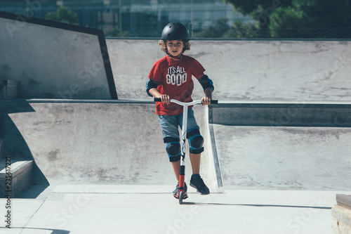 Young boy have fun in the skate park