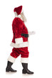 side view of fat merry santa claus walking