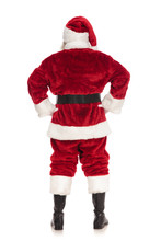 Back View Of Santa Claus Standing With Hands On Hips