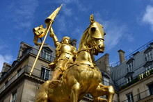 Paris, France. Jeanne D'Arc Golden Statue. Blue Sky With White Clouds.