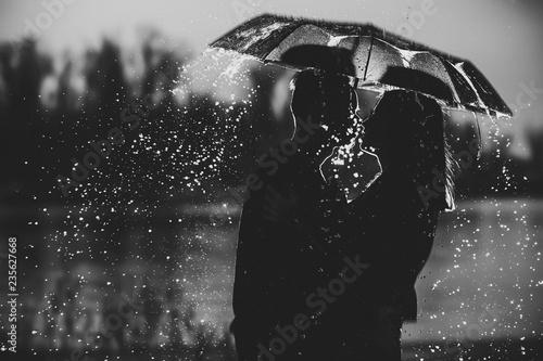 couple under an umbrella in the rain