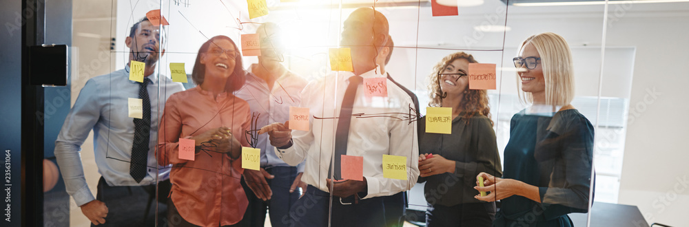 Fototapety, obrazy: Diverse coworkers brainstorming together with sticky notes in an