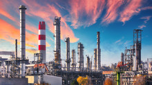 Pipeline And Pipe Rack Of Petroleum Industrial Plant With Sunset Sky Background