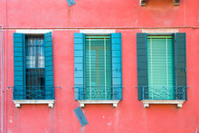 Windows On Red Wall In Old House In Venice