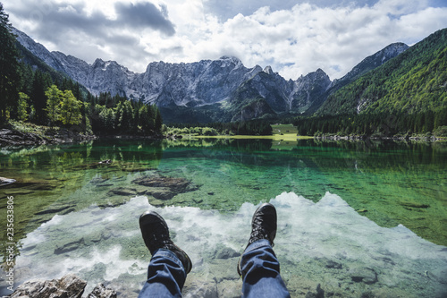 Poster Kaki View of a mountain lake Lago Fusine, Julian alps and Tirol. Beautiful and clear alpine lake with blue and green colors, deep forest and high alpine peaks and rock faces.