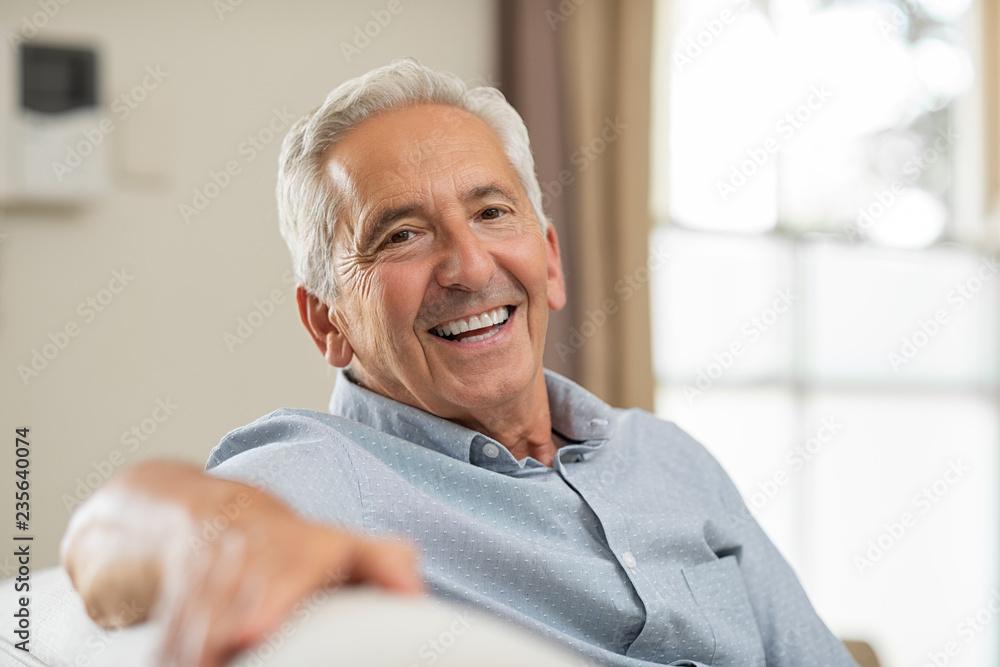 Fototapety, obrazy: Senior man smiling at home