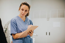 Young Female Nurse Taking Notes