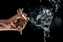Creative Background, Male Hand Clenches A Fist Of A Cigarette. The Concept Of Smoking Kills, Stop Smoking. Copy Space.