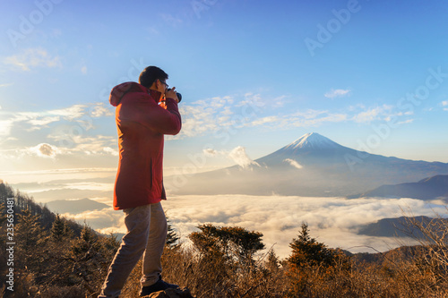 Asian Photographer Taking Landscape Photos Of Mountain Fuji
