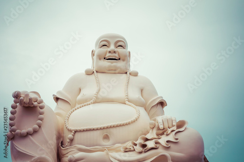 Poster Historisch mon. Massive statue of the Sitting Smiling Buddha at the Vinh Tranh Pagoda in My Tho, the Mekong Delta
