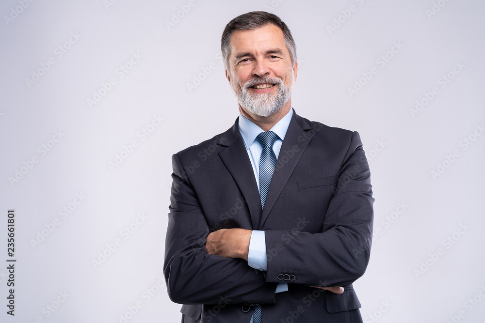 Fototapeta Happy satisfied mature businessman looking at camera isolated on white background.