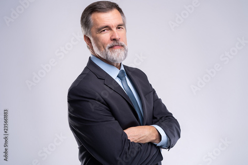 Cuadros en Lienzo Happy satisfied mature businessman looking at camera isolated on white background