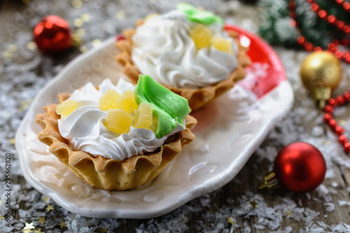 Fotografie, Obraz Delicious new year shortcake Basket  with whipped egg whites, decorated with p