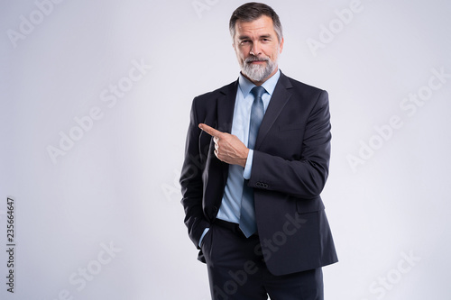 Portrait Of Happy Mature Businessman Presenting Isolated On White Background.