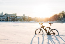 Winter Season Cycling. Black Bicycle On The Snow Inte City Center. Sport At Any Time Of Year Concept.