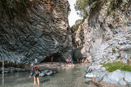 TAORMINA, SICILY / ITALY - OCTOBER 2, 2018: Tourists walking in Alcantara Gorge and Alcantara river park in Sicily Island, Italy Canvas Print