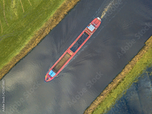 Top view of inland cargo ship Fotobehang