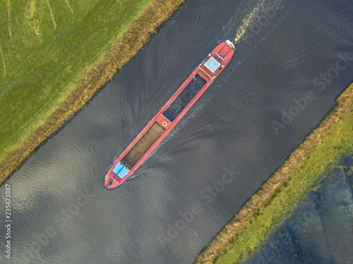 Papel de parede Top view of inland cargo ship