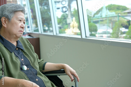 Fotografie, Obraz  bored depressed elder woman in wheelchair