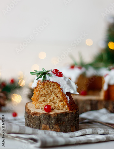 Deurstickers Dessert Christmas fruit cake, pudding on wooden saw.