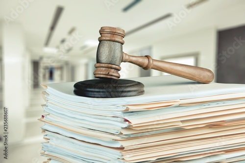 Fotografering  Judge gavel and documents, close-up view