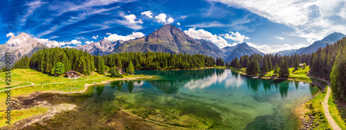 Recess Fitting Alps Arnisee with Swiss Alps. Arnisee is a reservoir in the Canton of Uri, Switzerland, Europe