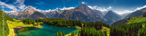Fototapeta Arnisee with Swiss Alps. Arnisee is a reservoir in the Canton of Uri, Switzerland, Europe obraz