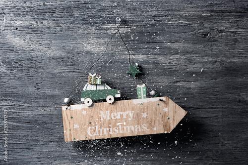 Fotografia, Obraz  text merry christmas in a wooden signboard