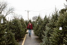 Woman Picking Out A Christmas Tree