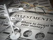 canvas print picture - Investmments and asset allocation concept. Where to Invest? Newspaper and direction sign with investment options.