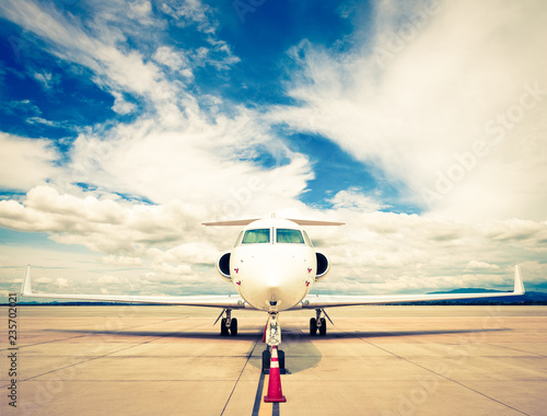 Fotografia Plane at airport with cloudy sky - retro vintage filter effect