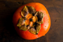 Overhead View Of Persimmon Fruit On Wooden Table