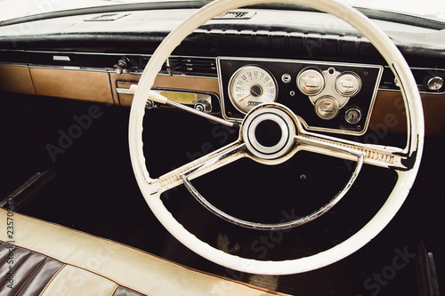 Vintage car steering wheel and dashboard