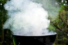 Close Up Of Smoke Releasing From Barbecue Grill