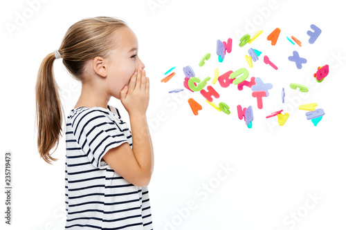 Fotografía  Cute little girl in stripped T-shirt shouting out alphabet letters