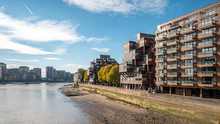 Modern Residential Architecture, River Thames, London. The Riverside Façade Of Contemporary Flats On The Thames On A Bright Autumnal Day.