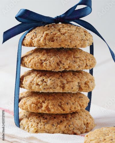 Tuinposter Koekjes oatmeal cookies and milk on white background. Rustic style.