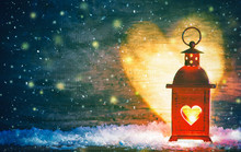 Red Lantern With A Heart Cut Out Lit By A Glowing Candle