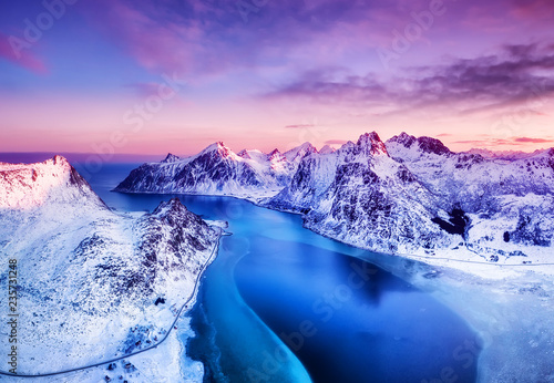 Fototapeta Aerial view at the Lofoten islands, Norway. Mountains and sea during sunset. Natural landscape from air at the drone. Norway at the winter time obraz