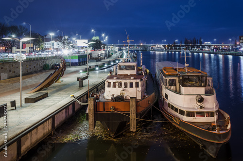 Keuken foto achterwand Poort NIGHT CITY - River ships at the city boulevard in Szczecin