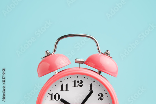 Stampa su Tela Red alarm clock on blue background